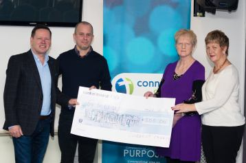 Presenting cheque to GROW charity